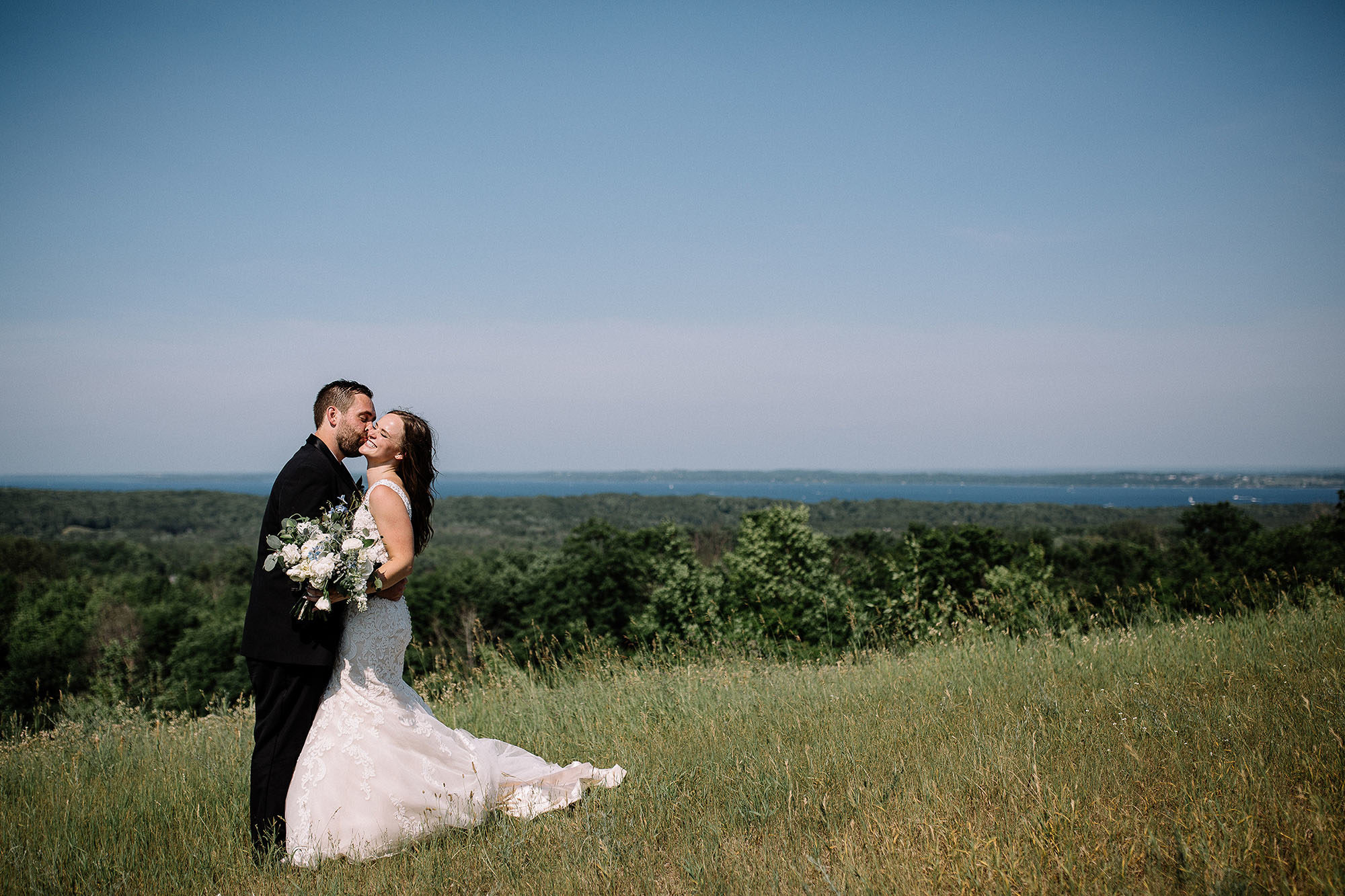 Bay View Weddings Bride and Groom with View of Grand Traverse Bay